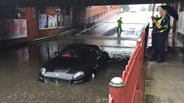 A Maserati was flooded after the driver tried to navigate a flooded underpass in Seddon on Saturday