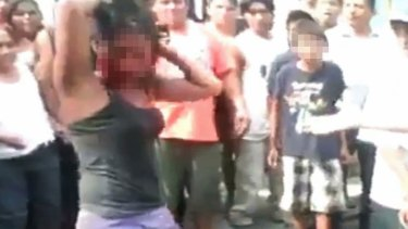 The mob surrounds the Guatemalan girl before she is set alight.
