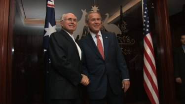 Then prime minister John Howard greets the US President George Bush in his Sydney office in 2007.