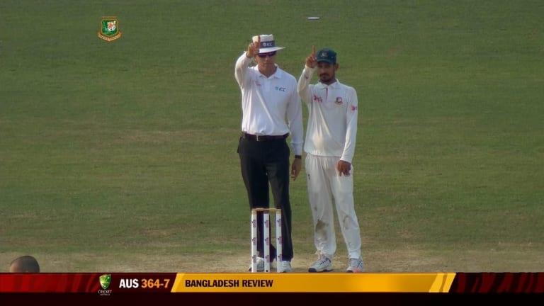 Nasir Hossain (right) follows the lead of Nigel Llong