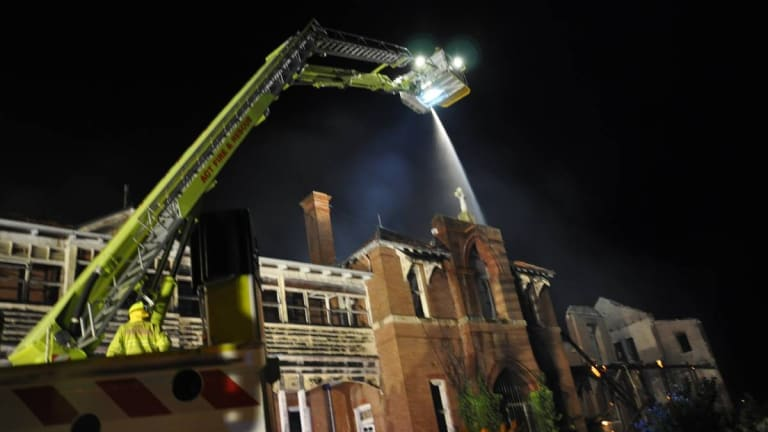An ACT Fire and Rescue 'Bronto' truck helps douse a fire at the Goulburn orphanage.