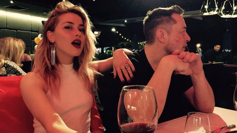 Amber Heard and Elon Musk are treated to some saucy dinner conversation on the Gold Coast.