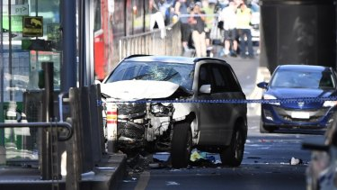 The SUV hit pedestrians before smashing into a tram stop.