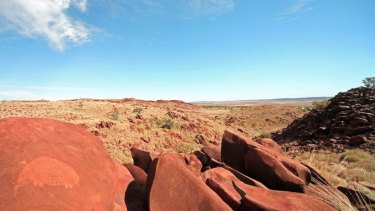 The country of the Burrup Peninsula, with petroglyph, or rock art, in the foreground.