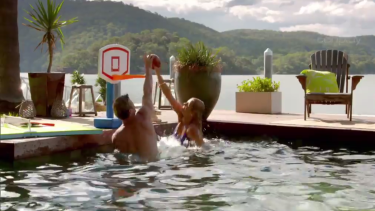 Richie and Faith playing basketball in the pool before a bit of banter.