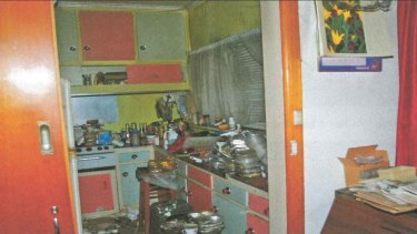"""The cluttered kitchen of a Blackburn North woman, a """"known hoarder"""", who died in a house fire in October 2012."""
