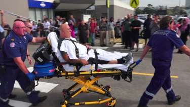 A victim is taken away after the shooting at Bankstown Central Shopping Centre.