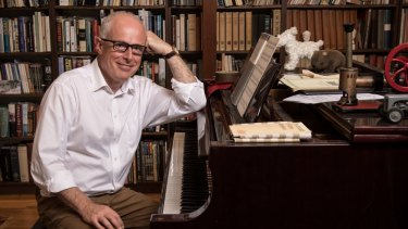 A man of ecelctic enthusiasms: John Vallance, the newly appointed State Librarian, in his home library.