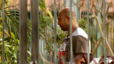 Myuran Sukumaran walks through the grounds of Kerobokan prison yesterday.