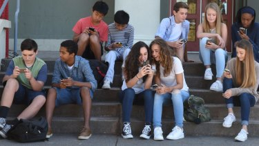 Obsessed with their phones: Teenagers in <i>Screenagers</i>.