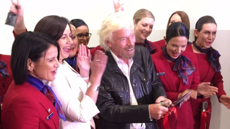 Sir Richard Branson celebrates opening the Virgin terminal with Qld Premier Annastacia Palaszczuk.