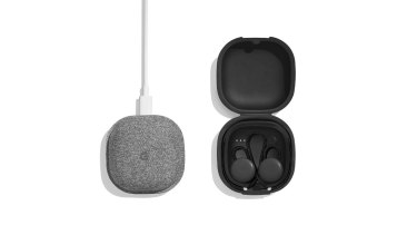 The Pixel Buds in their charging case.