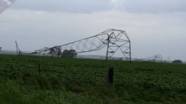 A transmission tower in South Australia is damaged following severe winds.