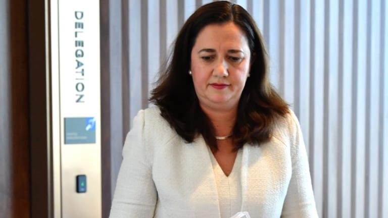 Annastacia Palaszczuk has been forced to defend her partner's role in the Adani loan approval process.