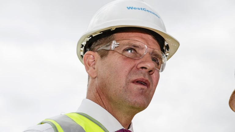 By the time Mike Baird signed contracts for the Sydney Light Rail project, the cost was $2.1 billion.