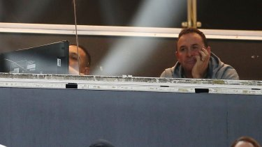 Ricky Stuart of the Raiders look on from the coaches box.