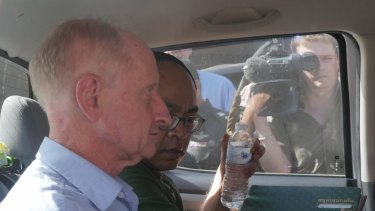 Peter Dundas Walbran in police custody in Ubon Ratchathani on Wednesday.