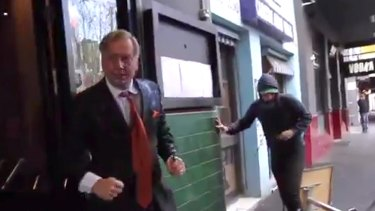 Andrew Bolt fights back against assailants on the streets of Carlton in Melbourne.