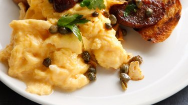 Scrambled eggs with chorizo and fried garlic.