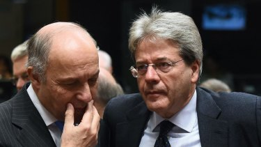 French Foreign Affairs Minister Laurent Fabius (left) speaks with his Italian counterpart, Paolo Gentiloni,  during an EU foreign affairs council at the European Council in Brussels.