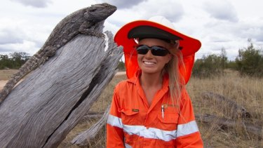 Tempe Parnell, a fauna spotter with Epicentre Environmental, with an eastern bearded dragon. The busines values its mobile site.