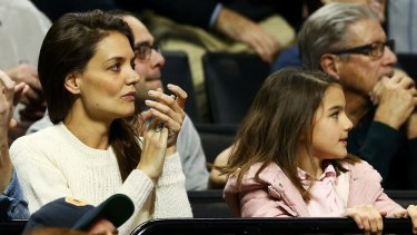 Katie Homes and daughter Suri Cruise watching a basketball tournament last year.