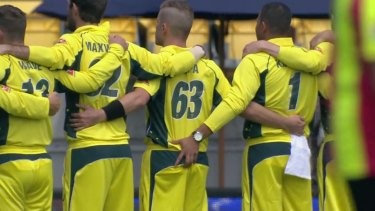 Australian opening batsman Usman Khawaja squeezes teammate Adam Zampa's behind ahead of the ODI against the Black Caps in Wellington.
