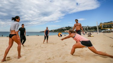 Coogee Beach visitors enjoy the hot weather on Sunday.