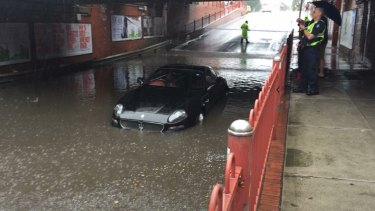 A Maserati stuck in floodwater during the storms in Melbourne.