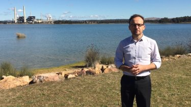 Greens deputy leader Adam Bandt in front of the Liddell and Bayswater coal-fired power stations.