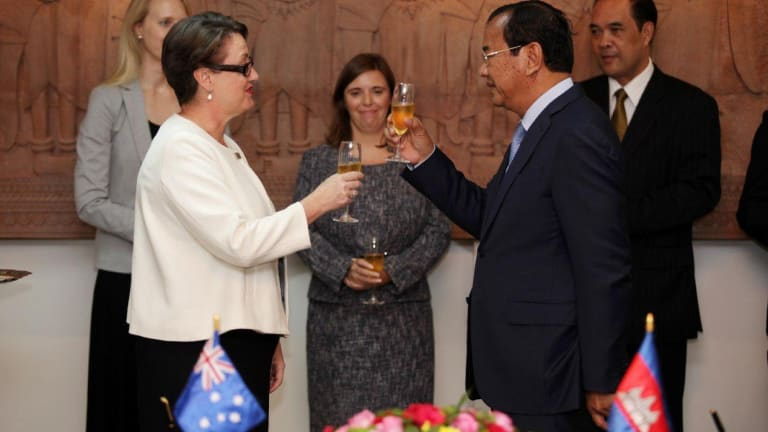 Australia's ambassador to Cambodia Angela Corcoran and Cambodian Minister of Foreign Affairs Prak Sokhonn toast the upgraded relationship in Phnom Penh on Wednesday