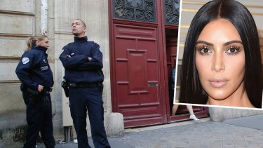 French police officers stand outside the residence of Kim Kardashian West in Paris.