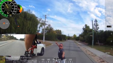 The moment the cyclist realises the man is brandishing a weapon.