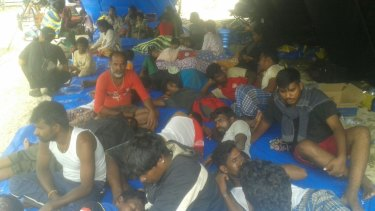 Sri Lankans were sheltered in a tent on the beach in Aceh over the weekend, while their boat was repaired.