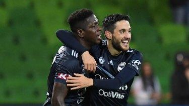 Leroy George celebrates a goal with Stefan Nigro.