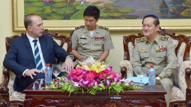 Peter Dutton (left) and Sok Phal (right) meet in Phnom Penh last month.