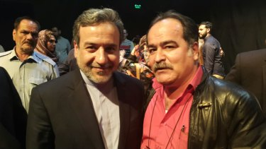 Iran's Deputy Foreign Minister Abbas Araghchi (left) with Hossein Babaahmadi, held in 2013 on Manus Island.