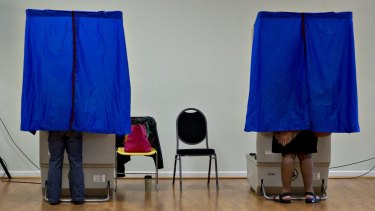 Residents use an electronic voting machine at a polling location in Philadelphia, Pennsylvania.