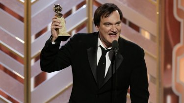 Director Quentin Tarantino accepts a Golden Globe Award for The Hateful Eight in January 2016.