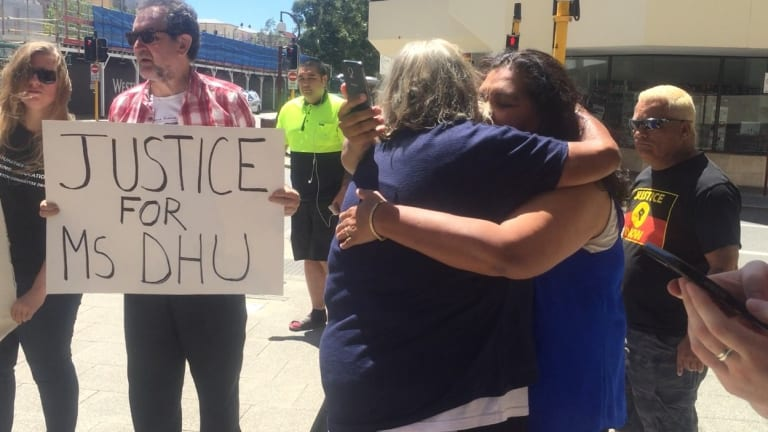 Ms Dhu's grandmother Carol Roe hugging a friend outside court.