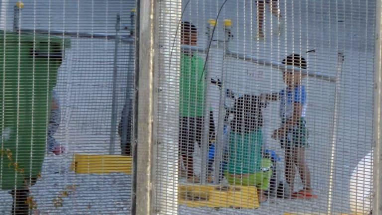 Children playing near the Refugee Processing Centre on Nauru.