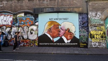 A political graffiti mural calling for people to register for the upcoming UK referendum depicts US presidential candidate Donald Trump and former London mayor Boris Johnson kissing.