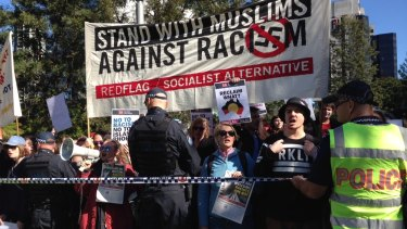 Scenes at the rally in Brisbane on Sunday.