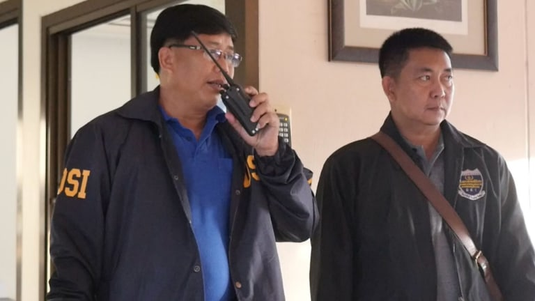 Thai police at the apartment of convicted Australian paedophile Peter Dundas Walbran, ahead of his arrest last December.