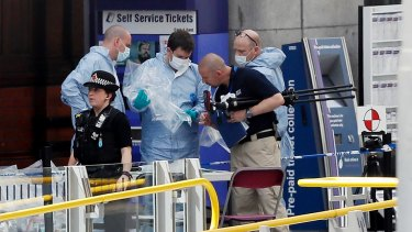 Forensic officers investigate the scene near Manchester Arena, where 22 people were killed.