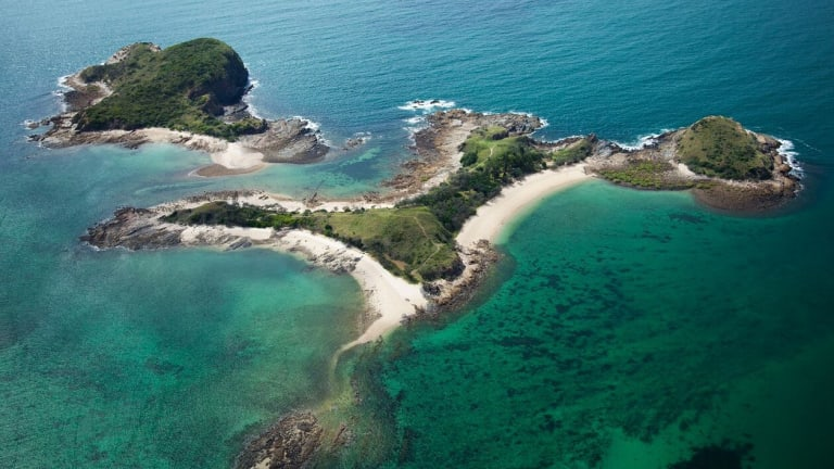 Online bidders are competing to be among the last visitors to XXXX Island.