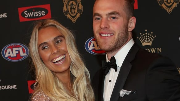 Pre-count favourite Tom Mitchell with his partner Hannah Davis.