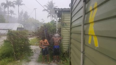 Men inside the now-closed regional processing centre at Manus Island, purportedly showering in the rain.