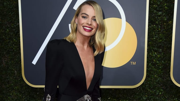 Margot Robbie arrives at the 75th annual Golden Globe Awards.