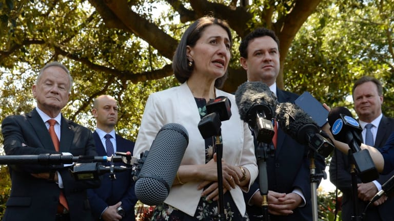 Gladys Berejiklian and Stuart Ayres announce the major stadium developments, flanked by  the heads of the various sporting bodies and trusts involved.